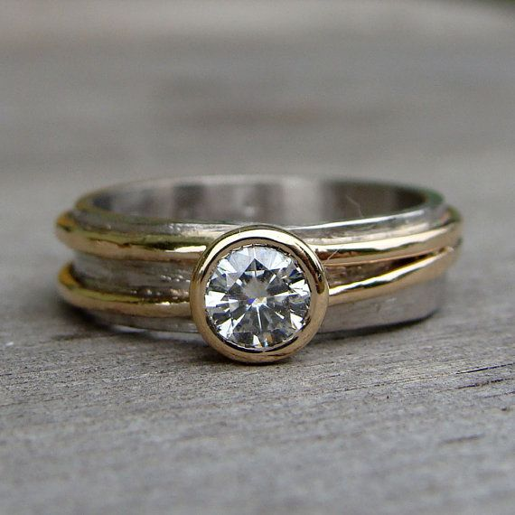 This ring has just the right balance of quirky character and traditional elegance. It features a 4.5mm moissanite (equivalent in size to a 0.33