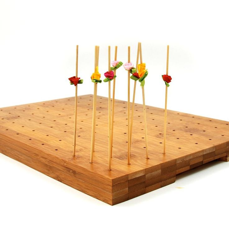 Skewers standing on a board wooden canape skewer display for Canape display stands
