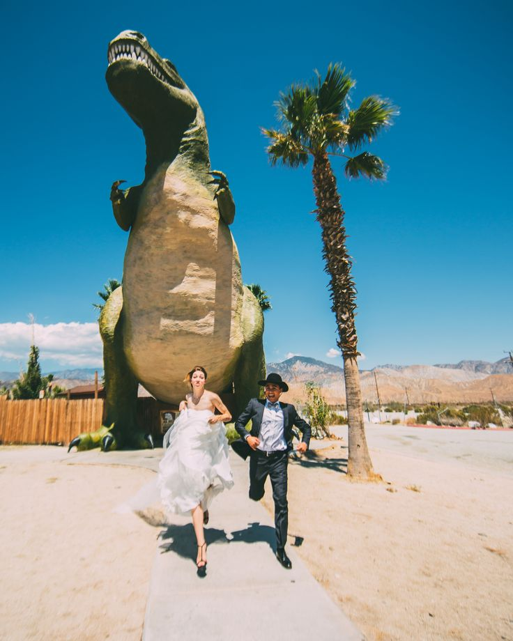 Wedding portrait by @christinaccraig at the Cabazon Dinosaurs in California    Dinosaur Wedding Photos Dinosaur Bridal Wedding attack photos