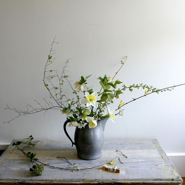 april flowers: narcissus + hellebore orientalis + amelanchier canadensis + forsythia + spirea branch.
