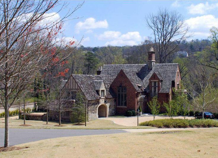 Stone and brick Tudor house by Bill Ingram Architect