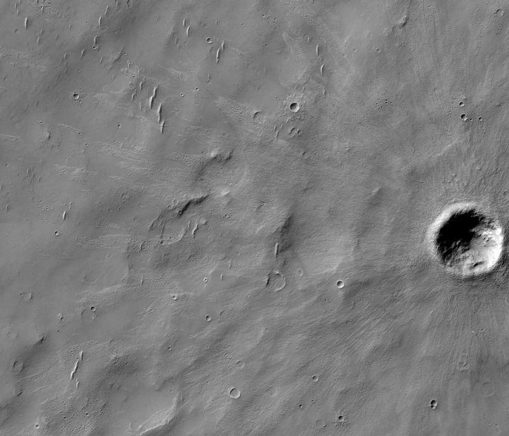 A Piece of Mars: At the lower right, a 240 m diameter crater tossed out ejecta on the surrounding terrain. But there are smooth patches where ejecta didn't fall. What I like about this is the many small bedforms, some of which are covered by ejecta and some of which aren't. Closer to the crater, you don't see so many of these bedforms because the ejecta is thick enough to have buried them. (HiRISE ESP_052794_1545, NASA/JPL/Univ. of Arizona)