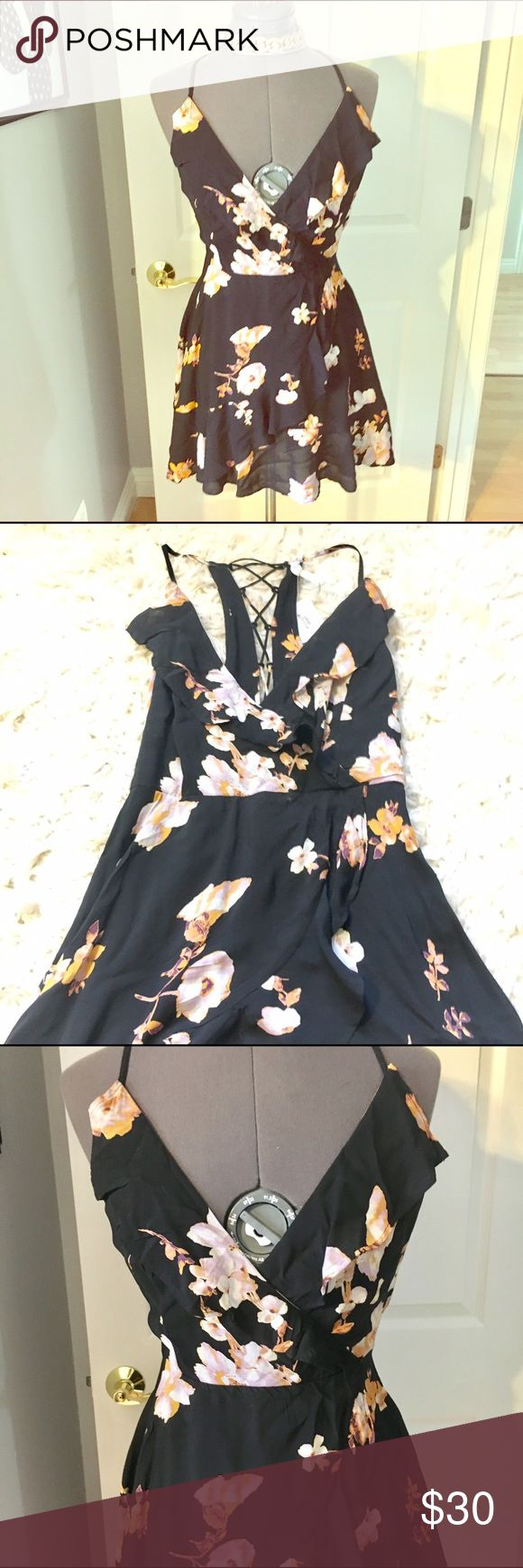 ⭐️NWT❤️ urban outfitters floral cami dress Feminine faux wrap dress with lace up back detail. Front bodice and skirt have fixed wrap look with ruffle. Zipper closure Urban Outfitters Dresses Mini