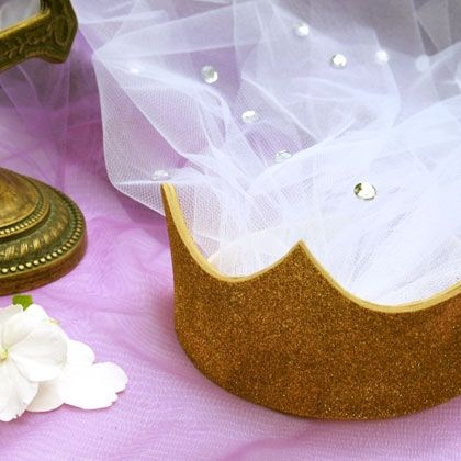 Fun Party Favors for little princess guests. With her days as a mermaid behind her, Ariel made a beautiful bride from the top of her head to the tips of her brand new toes. Like Ariel's, this wedding crown comes with a flowing veil and a golden tiara that are as shimmery as the sea itself.