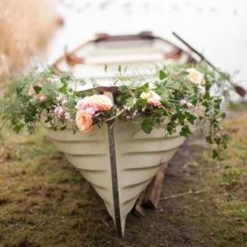 Gorgeously romantic inspiration for a lakeside wedding {Pic via 100 Layer Cake} - Gyles' boat!