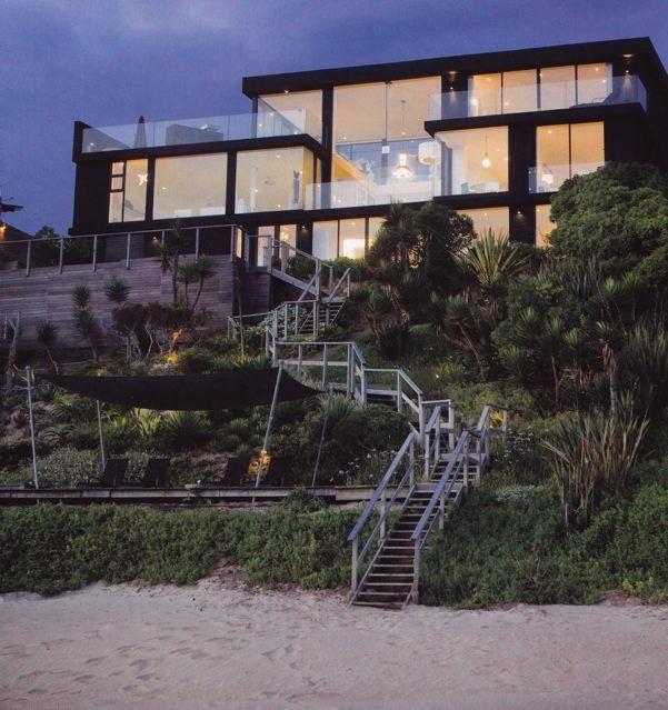 Trevyn and Julian McGowan - black beach house in Wilderness, South Africa