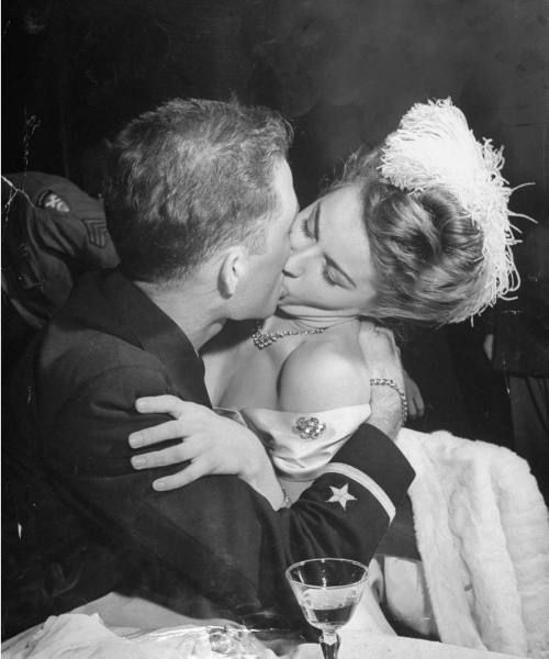An officer kissing a model at a nightclub. Photograph by Allan Grant. New York City, 1945.