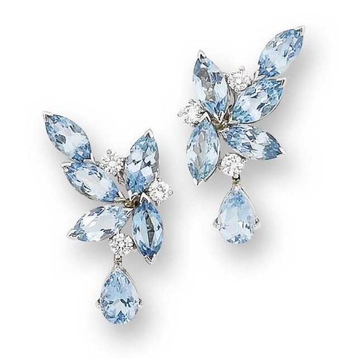 A pair of aquamarine and diamond earclips, by William Asprey for William and Son  Of stylised foliate design, each set with marquise-cut aquamarines and brilliant-cut diamonds, suspending a pear-shaped aquamarine drop, mounted in 18 carat white gold, diamonds approximately 0.90 carat total, maker's marks WRA, London hallmarks, length 3.6cm., cased by William and Son