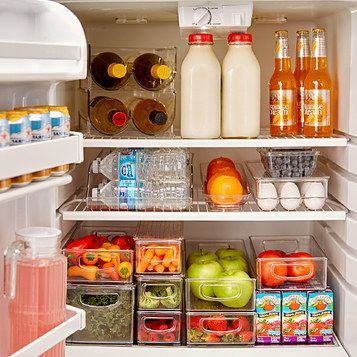 Organising the fridge with clever storage solutions and categorizing