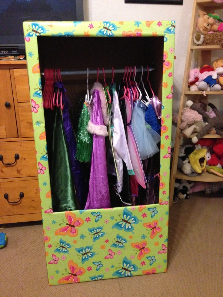 "Look what one customer did with her Shorty Wardrobe box! | ""My friend, Sarah Phillips, made this to house her daughter's dress up clothes. It's a u-haul wardrobe box. We moved the bar down about 8 inches, seal the box, and then cut the hole. Then we covered it in wrapping paper. I put a couple baskets in the bottom to hold shoes and accessories. Since it's made of cardboard it is easy to move to a different room."""