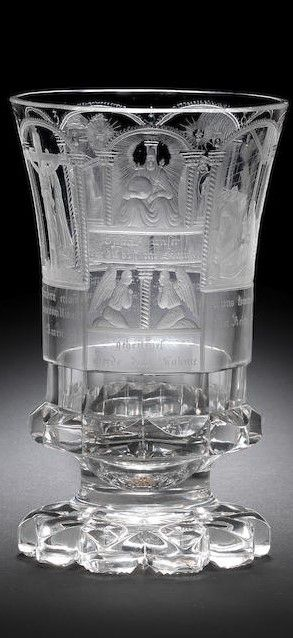 A North Bohemian engraved 'Vater unser' beaker, by Anton Simm, Gablonz, circa 1835 The flared campana form decorated with a representation of the Lord's Prayer, the front arched panel with a seated figure of the Lord inscribed Vater unser der du bist im Himmel (Our Father who art in Heaven), above two kneeling angels inscribed geheiliget werde dein Nahme (hallowed be thy name), flanked by a continuous series of six arched panels depicting various religious scenes, each inscribed with verses…