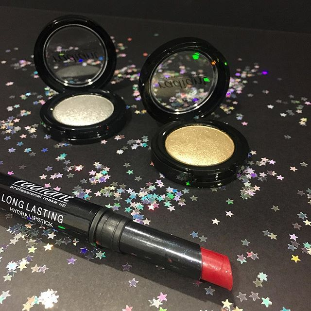 Killer make up look combination: Pair your sexy red lipstick with a gold & silver eye shadow! #radiantprofessional #makeup #beautyproducts #festive #essentials