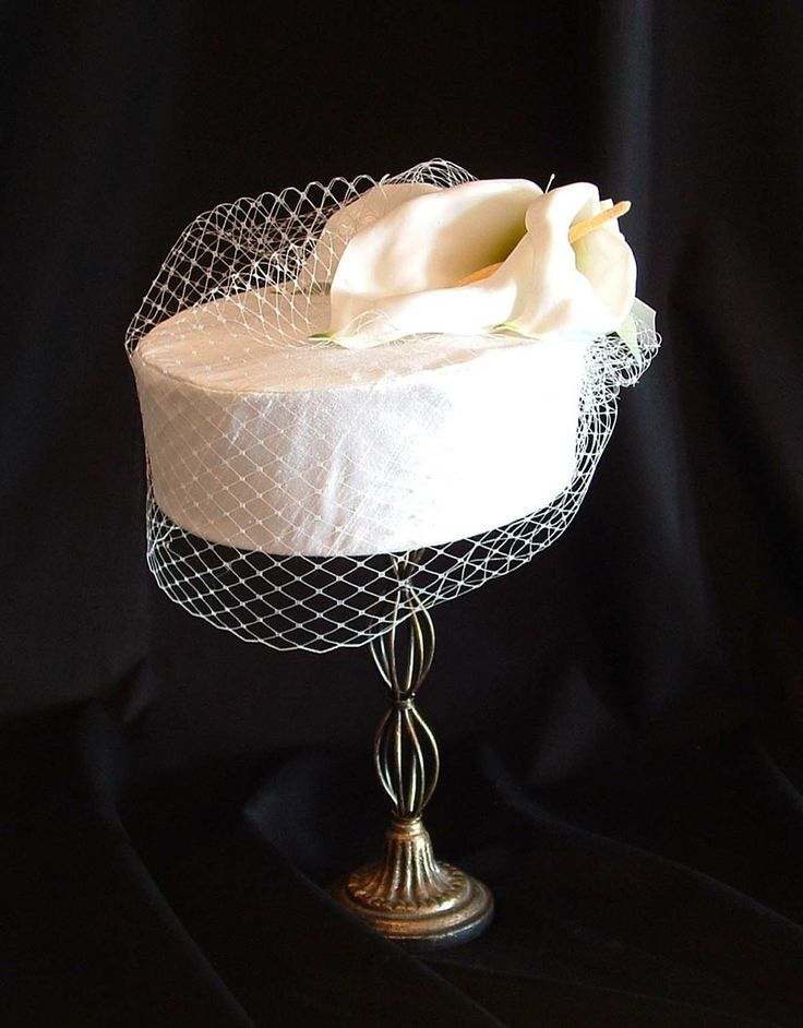Silk pillbox with veiling and lilies. $150 CAD (2013)