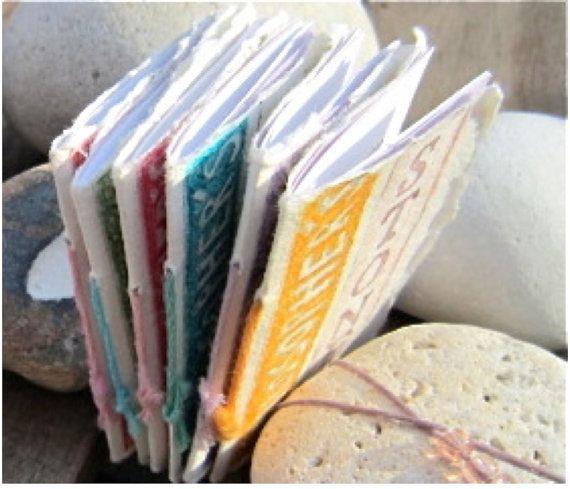 Wrapped stone poem philosophers stone artists by atelierartbook