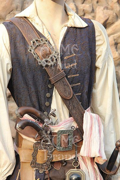 Beautiful Captain Jack Sparrow Embossed Leather Baldric & Buckle with scabbard (others on eBay do not). $295 opening bid. The listings on these expire but search around a little and you'll find a new listing.