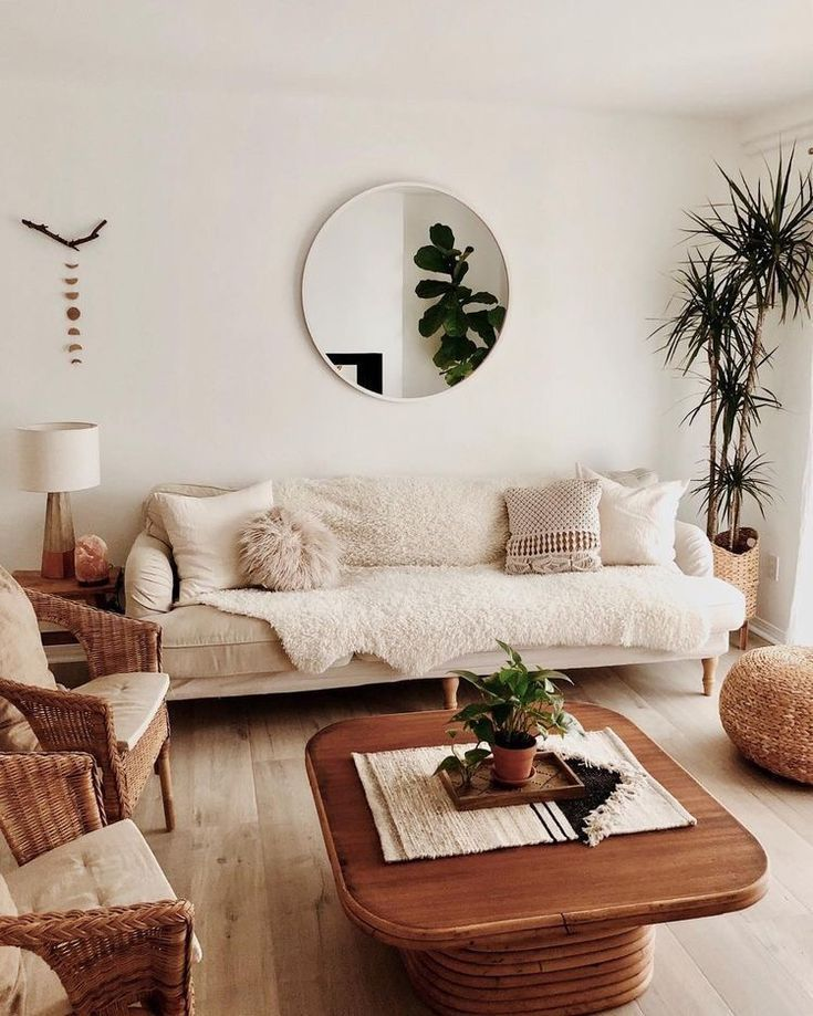 White Walls. Tan Furniture. Fake Plants.