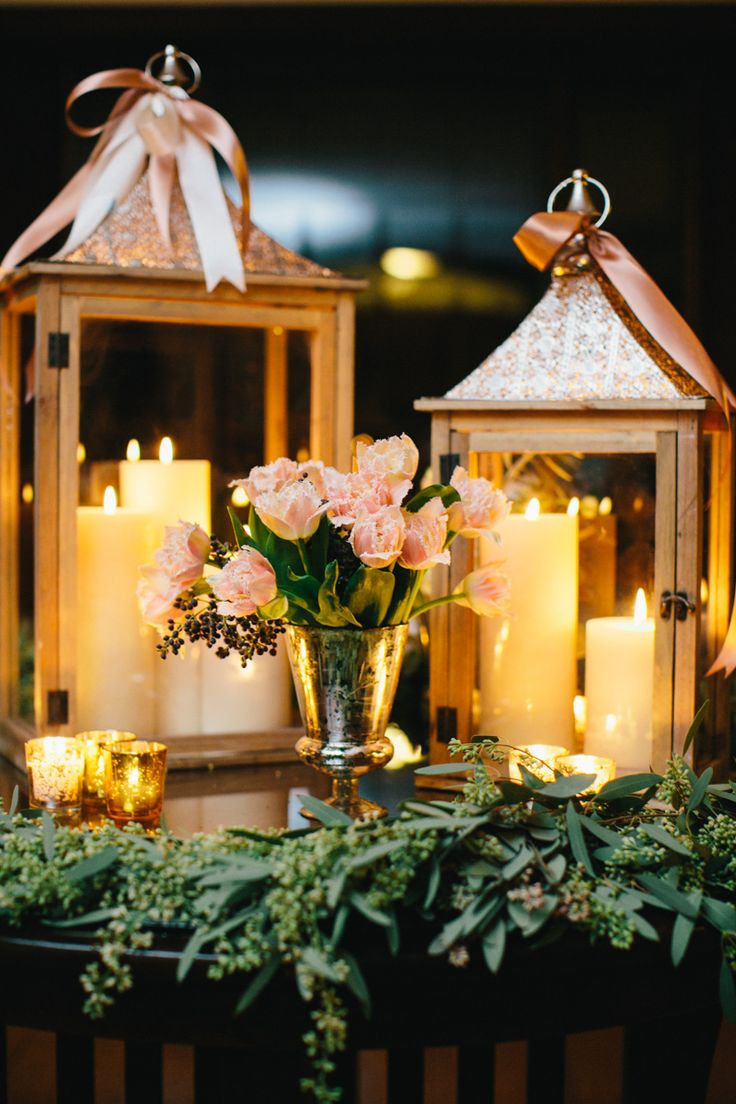 A wedding centerpiece with lanterns and candles