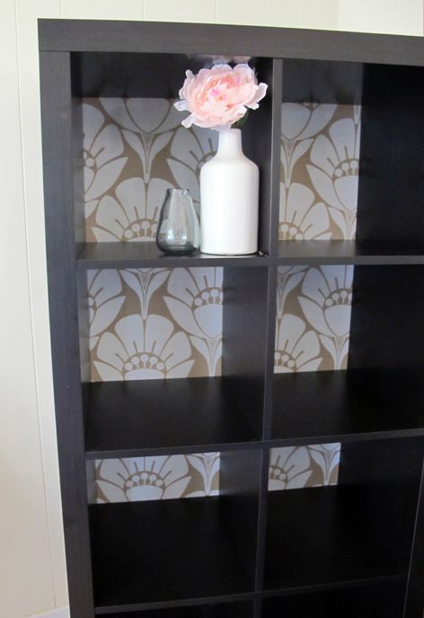 Fabric backing to backless expedit bookshelf. Even someone as non-crafty as me could do this.