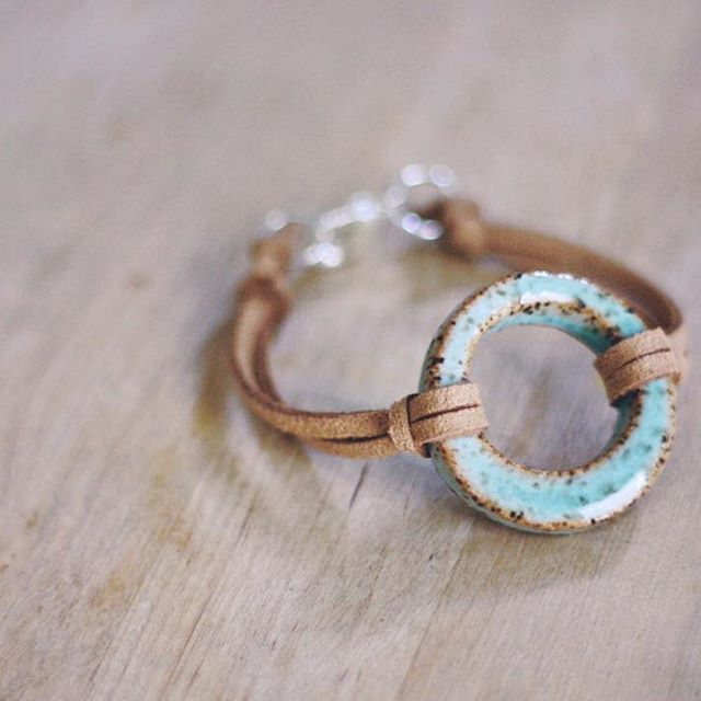 Stoneware Circle bracelet with light brown cord. Simple clasp closure.