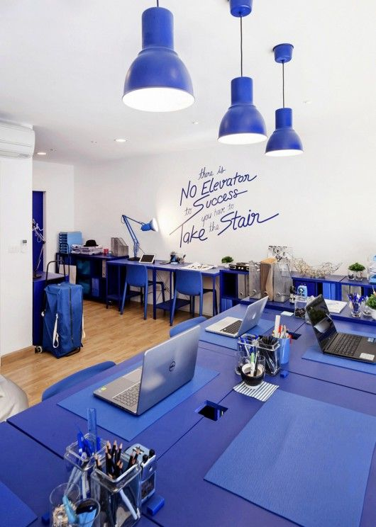 Blue office space with blue wall graphic quote. Office Design ideas