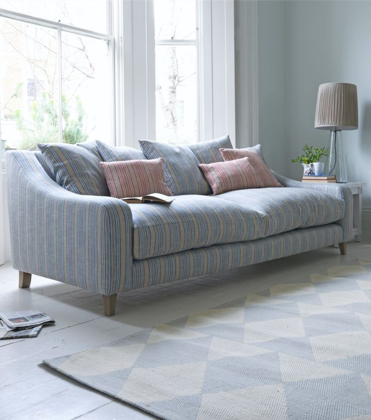 We finally cracked this sofa design on the night of the Oscars when we got the proportions spot on. It's every bit as insanely comfy as it looks. And the weathered oak legs get the award for Best Supporting Role. Shown here in Brittany Blue French stripe.