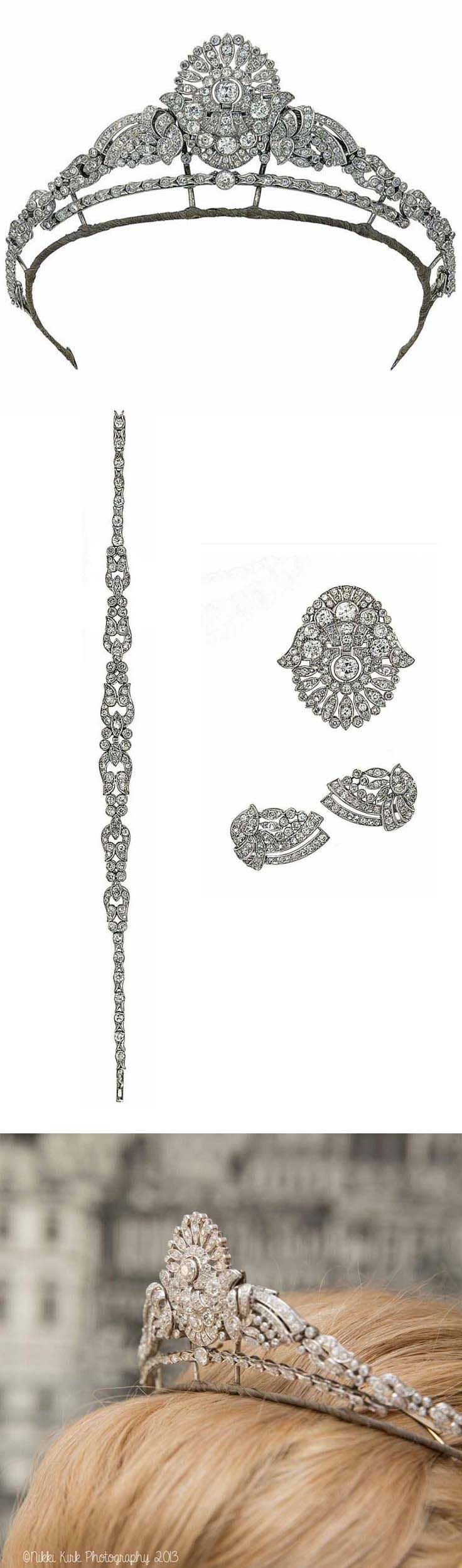AnAn Art Deco diamond tiara / necklace. The central plaque of stylised foliate openwork design set throughout with old brilliant and single-cut diamonds, between similarly-set foliate scrolls, to a tapering fancy-link necklace set with old-cut diamonds throughout, converts to a brooch, earclips and a bracelet, circa 1930, necklace and tiara fitting provided, in a fitted red leather case by            Garrard & Co.