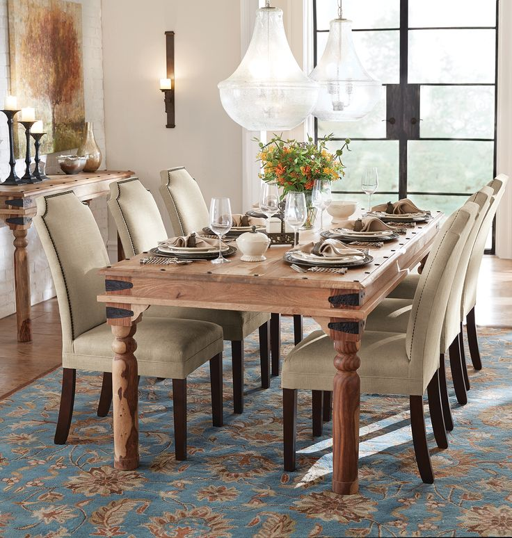 The Simple Yet Stunning Look Of Neutral Linen Upholstered Dining Chairs Dresses Up A Table
