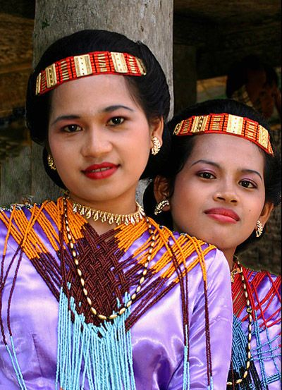 Tana Toraja wedding......Wedding celebration in Londa village, Tana Toraja. The women dressing in their traditional colorful clothes