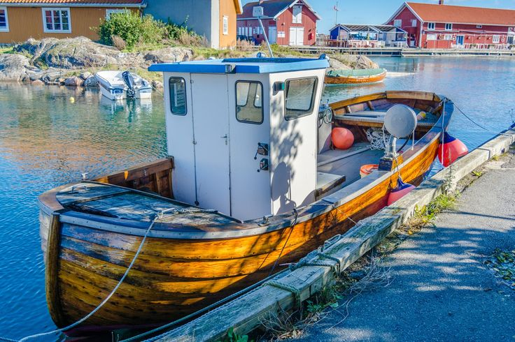 """Wooden boat - Small wooden fishing boat. This one looks like it has seen better days, but is still very much in use. Lovely little """"ship""""."""