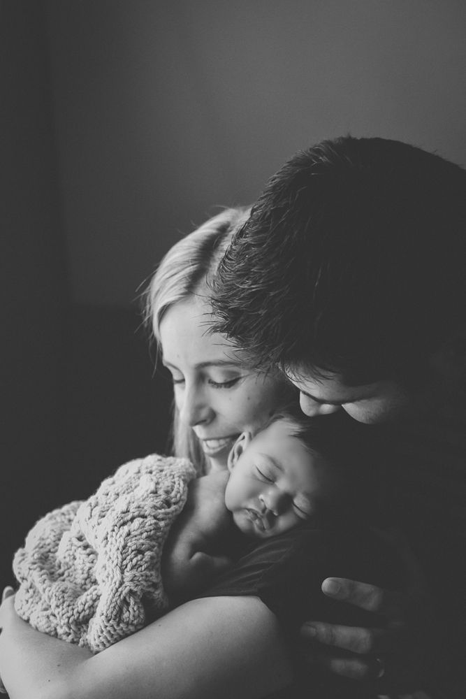 Newborn family portrait black and white photography pose