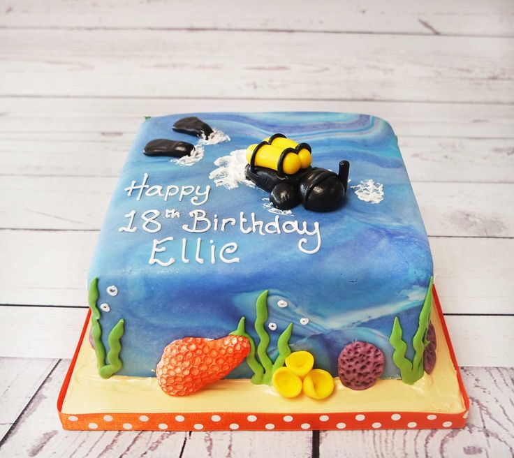 Beautiful scuba diving cake, the colours and detail bring this cake together to create a eye-catching personal cake.  #scubadivingcake   https://www.craftycakes.com/