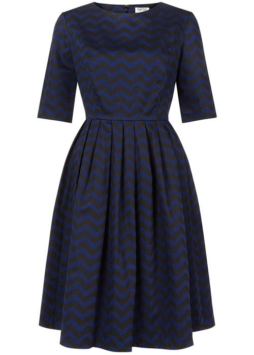 Navy flared dress with zig zag pattern in certified 100% organic cotton. Knee length flared zig zag pattern dress with elbow length sleeves and back zip fastening. Length 100cm.