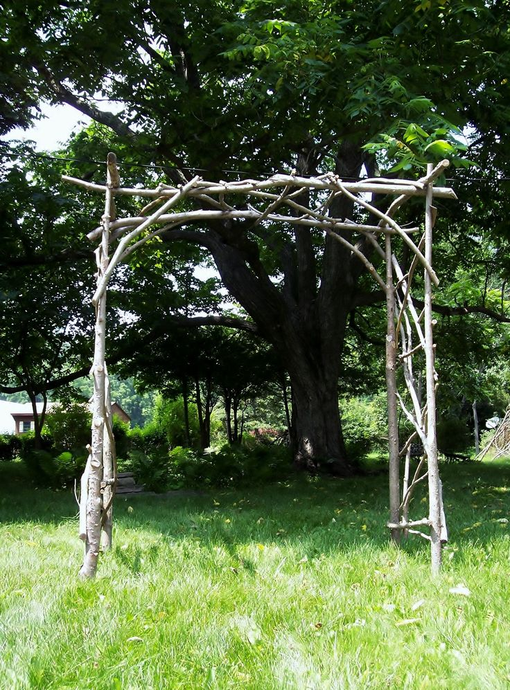 Rustic wedding arch and reuse in the garden with a ...