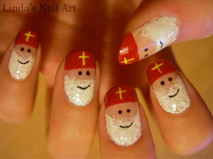 Nagels met Sinterklaas-hoofd met mijter.