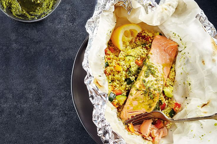 <strong>This all-in-one grilled meal has every component in a single pouch, so cleanup is minimal. Our trick to finishing the couscous, veggies and fish at the same time is to partially cook the couscous before steaming it in the pouch. Serve with lemon wedges.</strong><br><br>