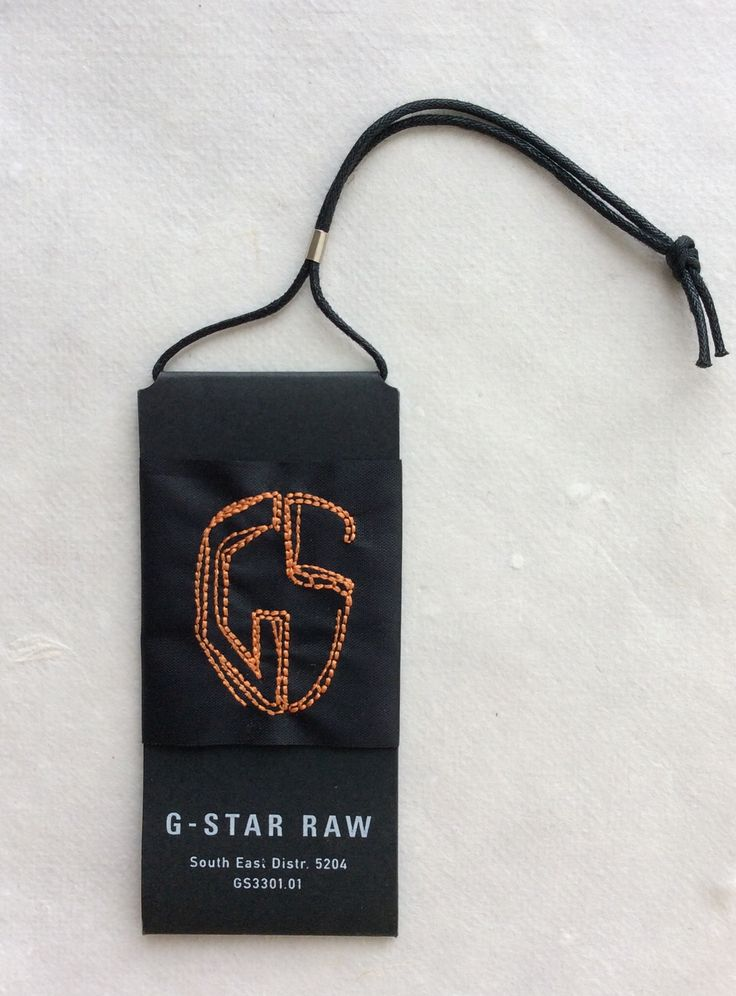 G star raw hang tag - printed folded carton & embroidered tape - waxed cord + metal trim. So much detail and attention
