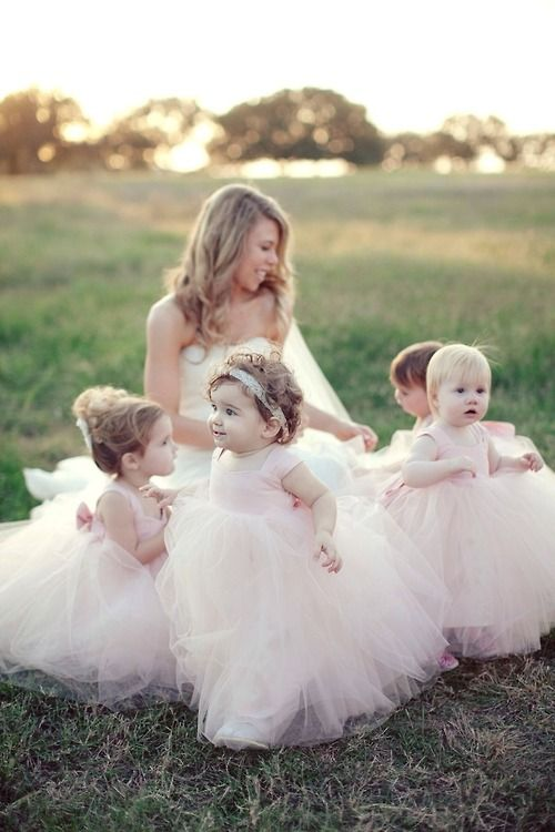 Bride surrounded with cute flower girls just like little fairies