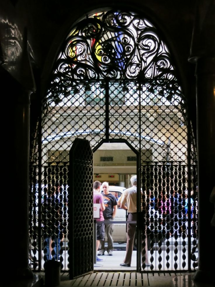 You'll enter Palau Güell through the arched entrance with its wrought iron privacy screen, unique in that it allows those inside to see out, but obscures the view looking in. Follow the link to find out more.  http://mikestravelguide.com/things-to-do-in-barcelona-visit-palau-guell/