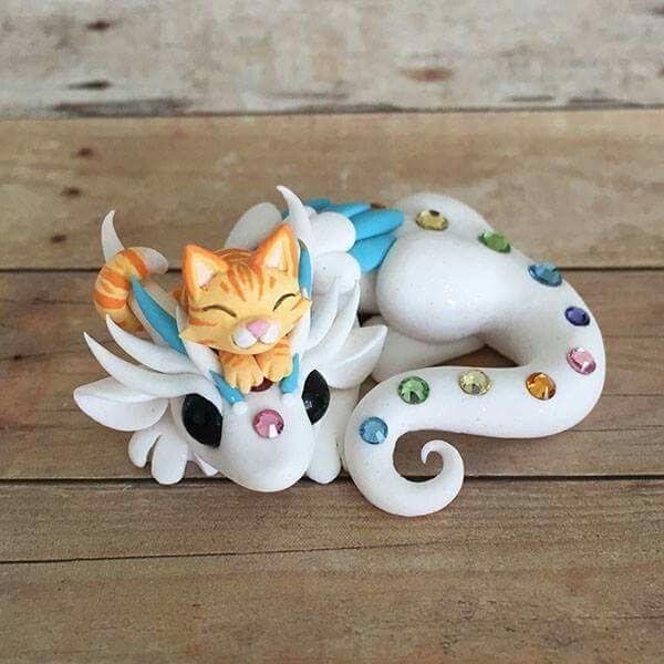 Polymer clay kitty on dragon