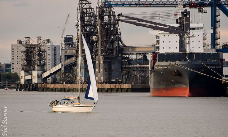 https://flic.kr/p/THjNrQ | Small yacht sailing down the Thames past Tilbury docks.