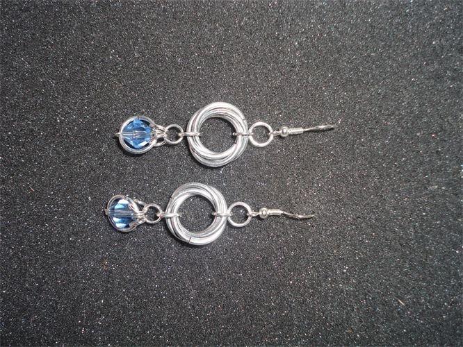 Mobius & Captured blue crystal earrings