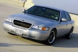 "2000 Mercury Grand Marquis LS Bought with 60,000 miles, currently 83,500  Appearance: Lowered 1.5"" front, 1.25"" rear 17"" bullitts with 255/50/17 tires 10% tint color matched rear fascia and grille tinted tails painted interior trim tach installed on a-pillar Scott Hrbacek custom white face gauges  Performance: 2.25"" dual exhaust, h-pipe, Mustang GT mufflers and 4"" rolled tips K&N FIPK rigged to be true cold air"