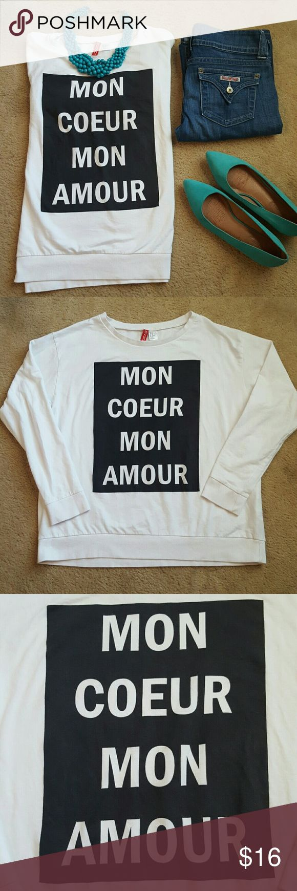 "✂FINAL PRICE✂ H&M Divided graphic sweatshirt Divided for H&M oversized lightweight sweatshirt. Wide neck. Graphic ""Mon Coeur Mon Amour"" meaning I love you with all my heart.   Excellent condition.   Size medium. Underarm to underarm 22"" length 24""  **shoes also available** H&M Tops Sweatshirts & Hoodies"