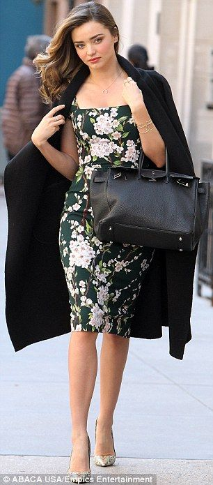 #springfashion #streetstyle | Miranda Kerr in a Saint Laurent black coat over a Dolce  Gabbana floral print sheath dress styled with Christian Louboutin snakeskin pumps  a Hermes tote