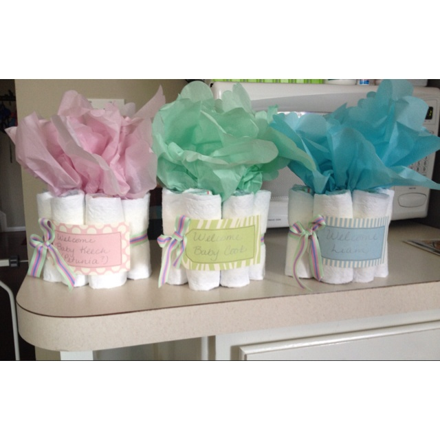 Baby shower centerpieces...diapers, ribbon, tissue paper and scrap booking paper.