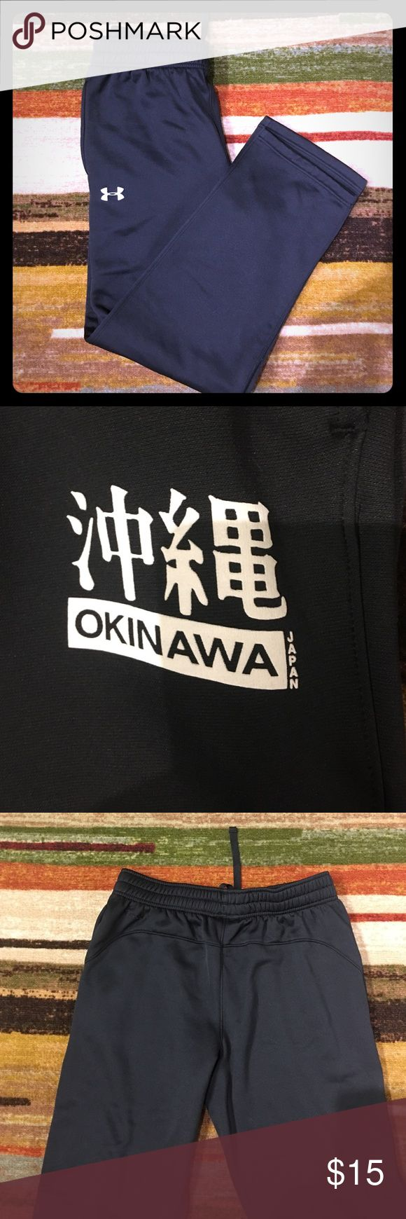 Men's UA warmups Black men's Storm UA warmups size L.  Okinawa Japan Logo on left pocket, Storm embroidery on left hip, drawstring waist, mesh lined pockets Under Armour Pants Track Pants & Joggers