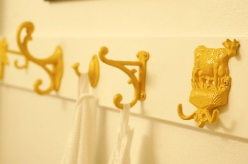 painted row of hooks for hall - assemble a host of different ones and paint in a fun color like turquoise?