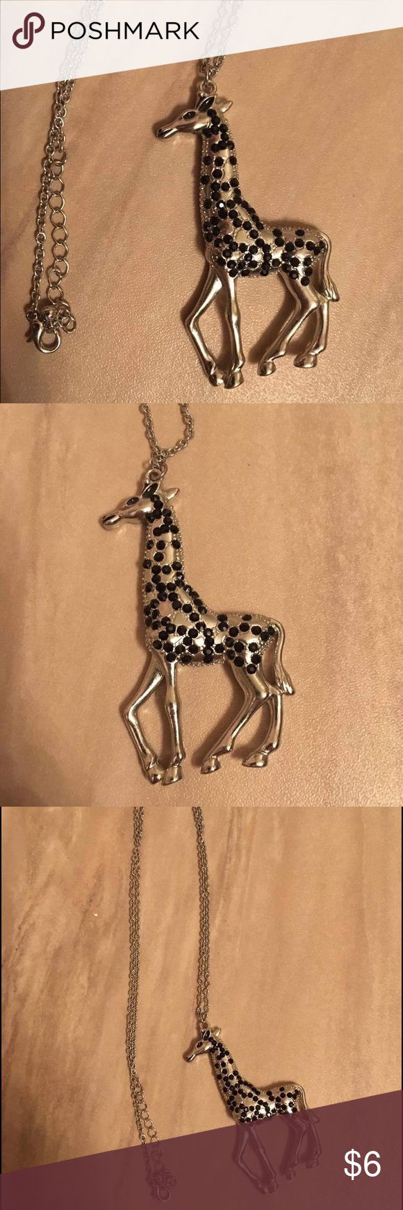 Forever 21 long silver giraffe necklace Silver long giraffe necklace from Forever 21- never been worn! Forever 21 Jewelry Necklaces