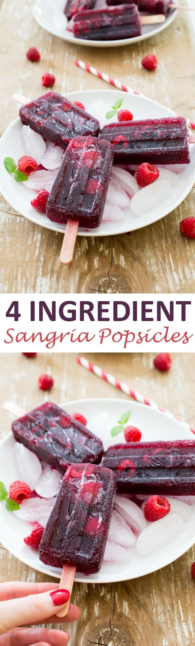 4 Ingredient Raspberry Sangria Popsicles. So easy to make and super refreshing. Perfect for a hot summer day!