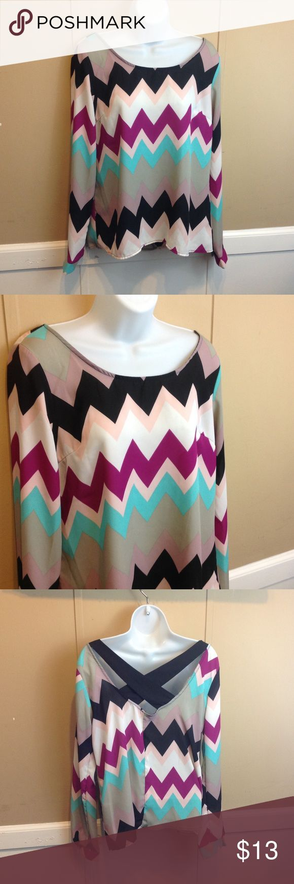 "Charlotte Russe Chevron Print Blouse Maker: charlotte russe ♥ Material: Polyester ♥ Color: Multi ♥ Measured Size: Pit to pit- 20"" Pit to cuff- 18"" Shoulder to waist-25""  ♥ Tag Size: Medium ♥ Actual Size: Medium PLEASE CHECK YOUR ACTUAL MEASUREMENTS TO MAKE SURE IT IS THE RIGHT SIZE! THANKS! ♥ Condition: Great ♥ Item #: (office use only) 600   Follow us on Instagram and facebook for coupon codes!  INSTAGRAM-thehausofvintage1984 Facebook- intergalactic haus of vintage 1984 or…"